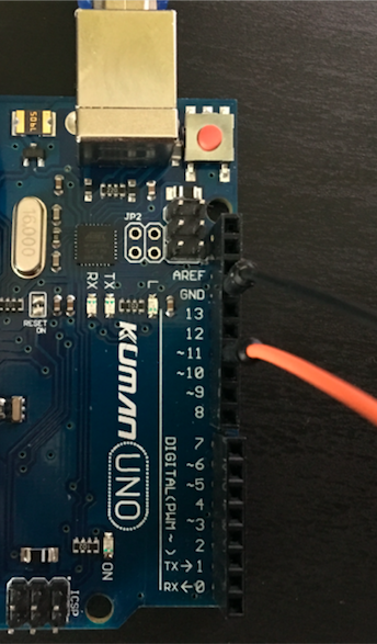 Arduino and two jump wire connected to pin 11 and ground pin