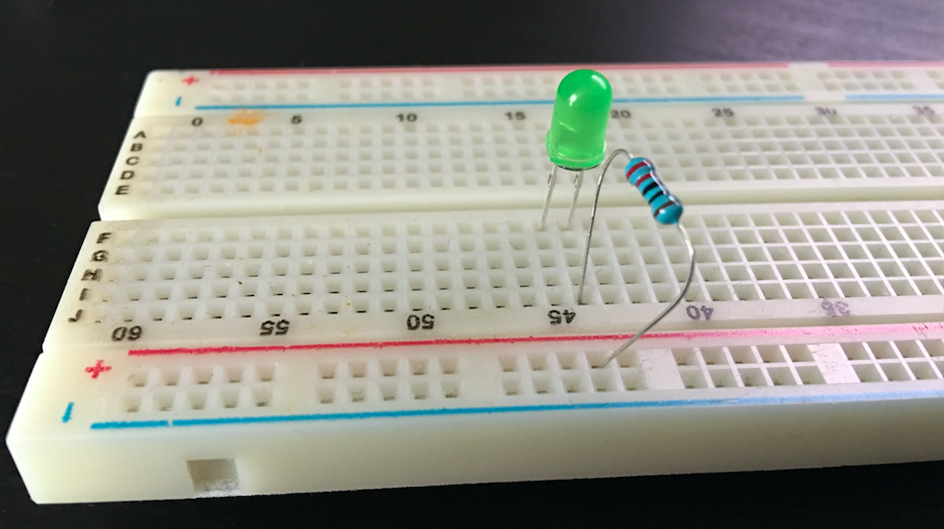 Breadboard with 220 ohm resistor and green LED